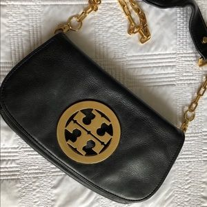 Tory Burch monogram leather clutch/crossbody